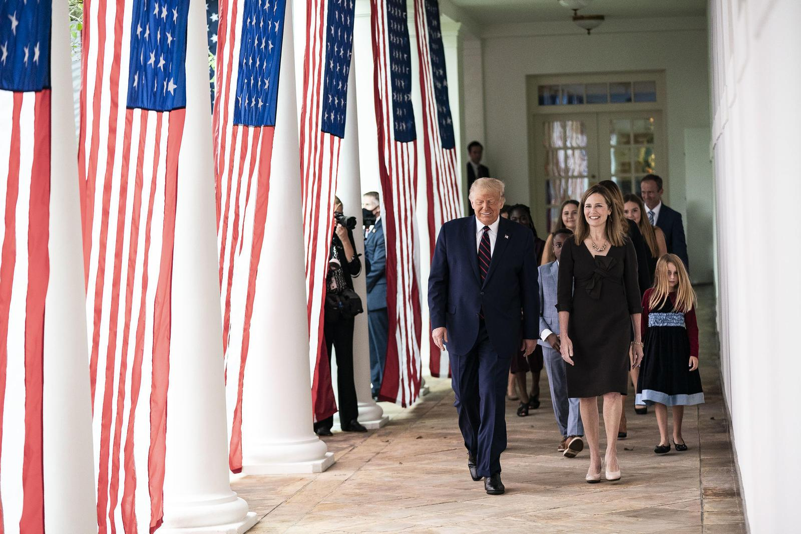 Donald Trump walks with Amy Coney Barrett