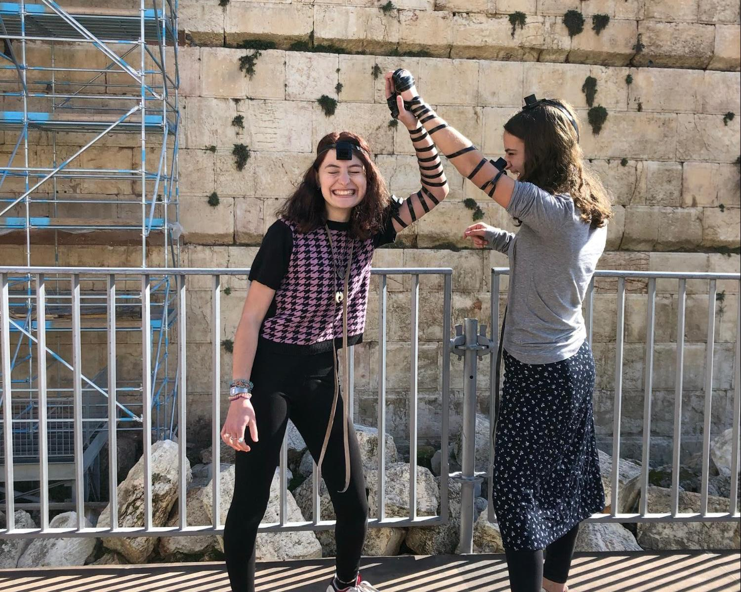 Maya Stutman-Shaw Wearing Tefillin with a Friend at the Western Wall