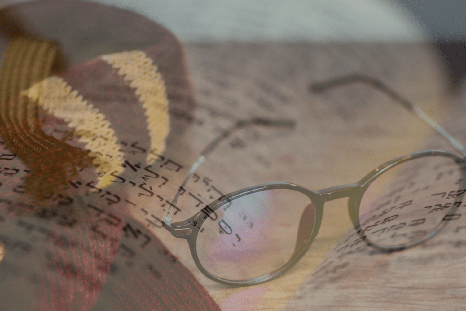 Composite image of Hebrew and Harry Potter glasses / scarf