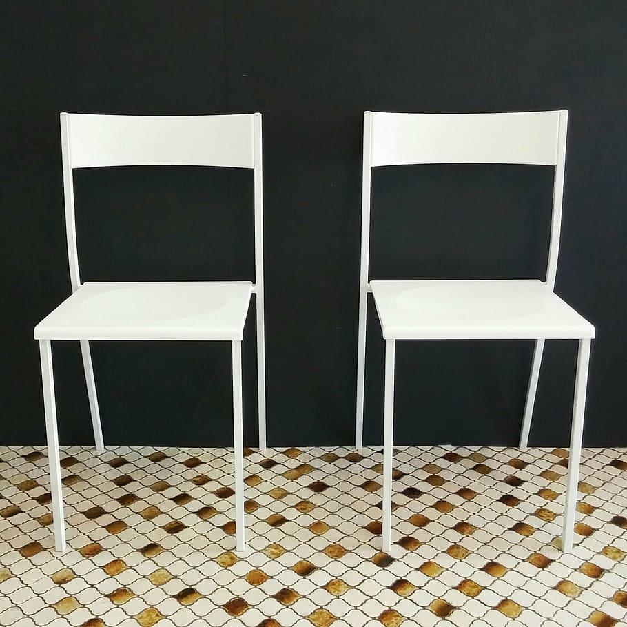 White chairs against a black wall
