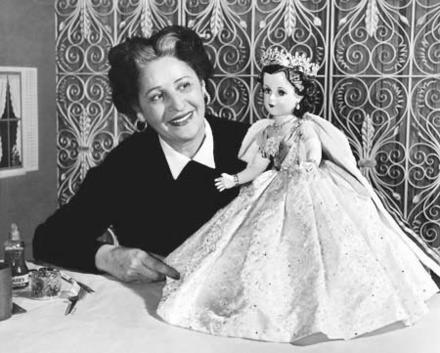 Beatrice Alexander Examining the Queen Elizabeth II Doll from the Coronation Set, 1953
